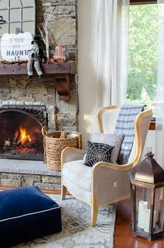 stone fireplace with wood mantel, burning fire, mirror, spider, blush, purple metallic pumpkins, halloween sign, skeleton Wooden Halloween Signs, Halloween Mantel, Halloween Decorations, Halloween 2020, Fall Living Room, Living Rooms, White Mantel, Classy Halloween, Blogger Home
