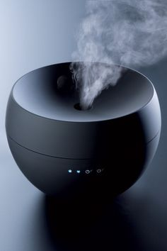Jasmine Aroma Diffuser - transforms water blended with essential oil into an extra fine mist. By Stadler Form.