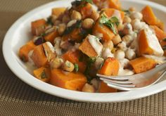 A favorite cool weather salad: Warm butternut and chickpea salad with tahini-lemon sauce! Easy, quick, and delicious. #vegan #grainfree @rickiheller