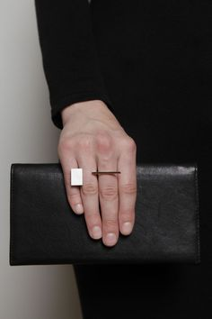 Geometric ring with open front, inspired by the work of Bauhaus master weaver, Gunta Stölzl. Handcrafted of sterling silver and 18k yellow gold.