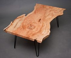 wood slab coffee table with hairpin legs.  I want to make this.
