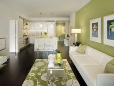 Olive Green / Sage accent wall, light color furnitures.