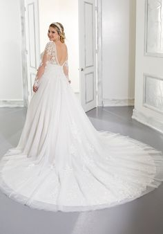 This ballgown wedding dress in tulle has long sleeves and a v-neck neckline. Wedding Dresses Photos, Bridal Wedding Dresses, Wedding Dress Styles, Dream Wedding Dresses, Designer Wedding Dresses, Dress Picture, Plus Size Wedding, Ball Gowns, Bride
