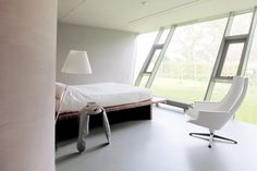 SODEA House is a minimal home designed by VMX Architects.
