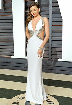 One sexy mama! Miranda Kerr flaunted her famous physique in a plunging, backless Emilio Pucci dress. Jimmy Choo heels and a Judith Leiber clutch finished the steamy style.