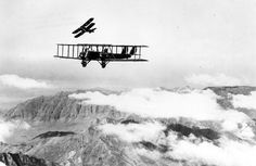 Martin MB-2 in flight with a pursuit aircraft practicing an attack