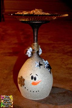 Wine Glasses sprayed with a metallic glitter on the outside and accented with bells, stars, ect... Plate Glued to the stem base for cookies