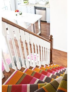 Vertical stripe stair runner -- love it!  Always looking for interesting ways to include a dash of color and interest to a space.