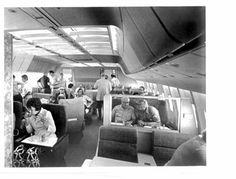 TWA L1011 special flight June 1972 on N31001, prior to inaugural TW L10 service.  View from door 1L, showing First Class lounge and cabin with 2-2-2 seating and swivel seats. There are publicity pics showing the dining tables set up on this very same aircraft .