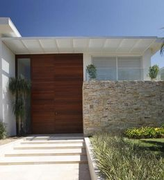 Wooden Door In White Wall Combined With Stone Fences For Contemporary House Design / Architecture Extraordinary Contemporary House Designs Ideas For Your Space