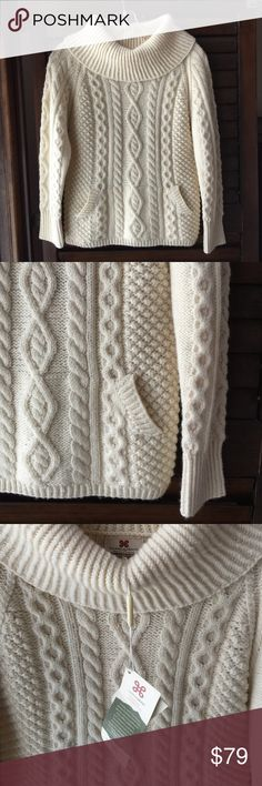 Carraig Donn wool sweater- NWT- size small Carraig Donn 100% merino wool sweater - NWT- size small. Handknit in Ireland.  Features a roll neck, front kangaroo pocket, and traditional Aran patterns that are known worldwide. Excellent quality. Beautiful and so cozy! Carraig Donn Sweaters