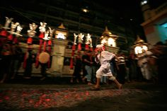 A Shiite Muslim boy runs on burning charcoals as a part of the Ashura religious festival in Yangon on Nov. 24. Shiite mourners beat themselves during Ashura with steel-tipped flails or slash their bodies with knives to mark the death anniversary of Imam Hussein, a grandson of the Prophet Mohammad, who was killed during a battle in A.D. 680 in Kerbala, a city in modern-day Iraq. (Reuters) #