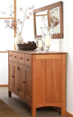 Modern Shaker Long Sideboard.  This piece features four top drawers with four bottom doors offering optimal storage space for your kitchen or dining room. $5,565.00