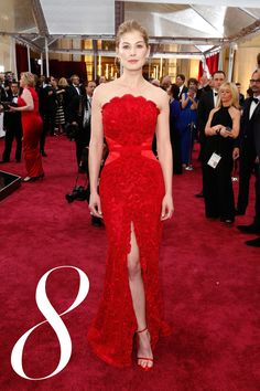 After an awards season of mixed reviews, Pike will be most remembered for her flawless crimson lace Givenchy moment at the show that matters most.    - HarpersBAZAAR.com