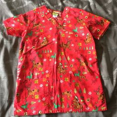 Scooby-Doo scrub top, xs Wore only once. In like new condition. Two front pockets and has slits on bottom of sides. Armpit to armpit is 19.5 inches and top of shoulder to bottom of top is 28 inches. Feel this fits more like a small so listed that way. Questions please let me know. Tops