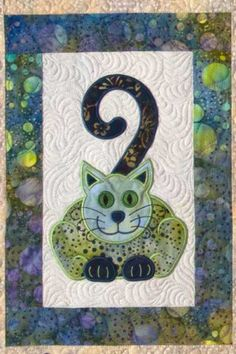 Cat's Meow quilt with machine embroidery, design by Lunch Box Quilts
