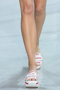 Red and white slide sandals at Lacoste spring '16.
