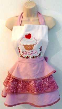 Apron stitched with machine embroidered breast cancer awareness designs.