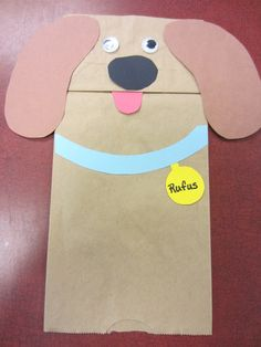 Terrific Twos made their own doggy paper bag craft.  Find the template for the collar and more here: http://www.freekidscrafts.com/wp-content/uploads/paper-bag-dog-puppet-pattern.jpg
