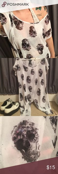Hot Topic Flower Skull shirt ✨Size XL flower skull shirt from hot topic. The sides flow down to your knees, and the back opens up. It's super cute with. Black leggings a bralette, and creepers. Only worn once.✨ Hot Topic Tops Blouses