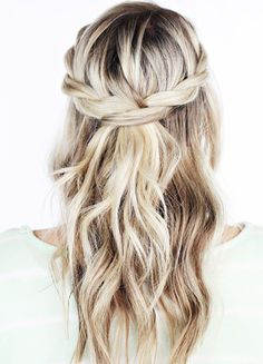 To start, part your hair, as you would, to create a classic half-up, half-down hairstyle. On one side, take the section of hair you'll be pinning back, and braid all the way down. Secure with a bobby pin in the back. Do the same with the other side, except when you go to pin, pull open the first braid and thread the new one through. That's it. Five minutes to an ultra pretty infinity braid.