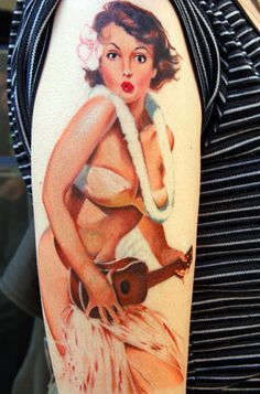 """A gorgeous vintage pin-up tattoo design. This pose is what is known as a """"suggested nude"""" - the model isn't fully clothed, but her most intimate areas are still covered. Love the island flower in her hair :)"""