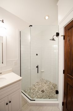 HUGE Bathroom Remodel for the New Year - Top 2016 Bathroom Trends, Whites and Grays, Oversized Victorian Style Tub, Glass Walk-In Shower with Stone Flooring, Double Vanity with Double Mirrors, Wood Tile Flooring - Re-Bath of the Triangle.