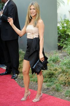Jennifer Aniston Envelope Clutch - Jennifer paired her two-toned dress with a crocodile textured clutch. Brand: Ferragamo