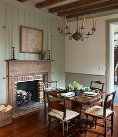 Classic Country Fireplace Soothing colours and antique wood furniture contribute to a farmhouse-inspired space (note door frame is same color as the panelling ) love the idea of fireplace on dining area Farmhouse Fireplace Mantels, Country Fireplace, Fireplaces, Fireplace Ideas, Brick Fireplace, Farmhouse Windows, Rustic Farmhouse, Classic Fireplace, English Farmhouse