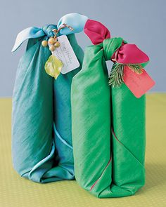 Fabric Bottle Wrap  Elevate traditional hostess gifts, such as wine, olive oil, or flavored vinegar, by packaging the bottles in colorful fabric that can be used again and again. Doin' this!