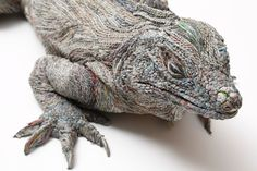 Chie Hitotsuyama iguana closeup While origami results in some pretty incredible paper animals, no folded crane can hold a candle to these intricate and insanely accurate creatures created by Chie Hitotsuyama. The Japanese paper artist gives everyday newspaper a new life by folding, rolling, and stacking it into the form of some of the world's most recognizable animals, and some of her paper creations are practically life-size.