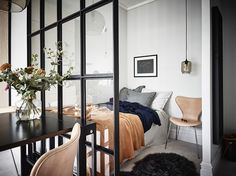 Tiny studio apartment with glass dividing wall