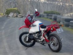 Two replica BMW 1200GS Adventure motorcycles, one of Ewan McGregor and the other of Charley Boorman. The replicas stand out thanks to the same leopard