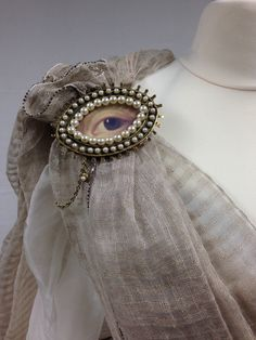 Oversized Lover's Eye Brooch worn by Gellis Duncan (Lotte Verbeek) in Outlander. Terry Dresbach, creator of the costume, points out that the craze for the jewelry didn't actually come about for a half-century or so, but it fit the character so well that the decision was made to depart just a bit from 18th-century fashion.