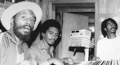"""Sound-engineer ERROL BROWN, here with songwritter SANGIE DAVIS and JUNIOR MARVIN, mixing Bob Marley's LP """"Survival"""" at Tuff Gong Studios, '79 © Lindsay Oliver Donald"""