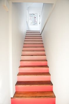 Painted stairs in salmon and blush colors