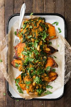 This hearty vegan dinner features a homemade white bean masala sauce with creamy kale that's used to smother whole roasted sweet potatoes.