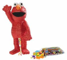 """Elmo 21"""" Pull-String Pinata Pinata Kit including Pinata and 2 lbs of Candy and Toy Fillers by Unique. $35.69. Includes (1) pinata and (1) 2lb pinata filler. Filler includes approximately 2 pounds of candy and toys, including Laffy Taffy, Smarties, Tootsie Rolls, among others. Caution: not recommended for children under 3 years of age."""