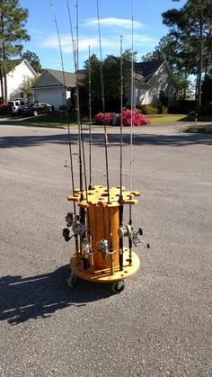upcycled wooden cable spools _ fishing rod holder_allcreated