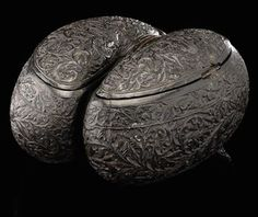A CARVED COCO-DE-MER, WEST COAST OF INDIA OR CEYLON, 18TH CENTURY