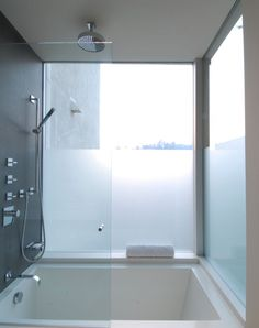This could be a good idea for small space.  Start with Japanese sitting tub as base for shower booth.  Have your cake....