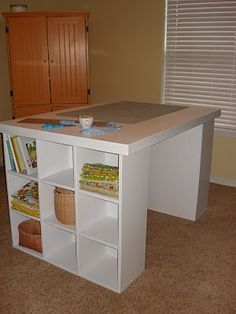 Two 9-drawer cubbies and a flat (door) top table would make an Awe-mazing craft center (if only I had the room). Chestnut Sparrow: Cutting Table with Storage....You can make one too!