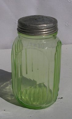Green Depression Glass Shakers- I have a whole set of these that were my grandmother's! Makes them extra special