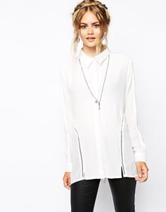 Every lady needs a classic white shirt- and this MINKPINK number for AW14 has just enough detailing to make it a spin on the old
