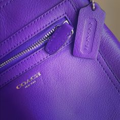 Purple COACH Crossbody REAL Coach purple leather crossbody bag! Very vibrant in color - used ONCE! One zipper pouch on the outside. Inside is a grey material. Strap is adjustable to fit all heights! NO TRADES Coach Bags Crossbody Bags
