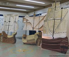 The school auction uses these ships every year as a beautiful backdrop to the guest photos.  I'm not sure how they store them ... they must collapse. #BenefitAuctionDecorIdeas