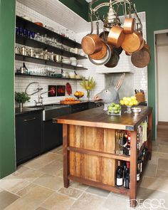 open shelving, giant butcher block island but in older, darker, heavier wood