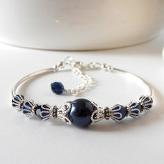 Hey, I found this really awesome Etsy listing at https://www.etsy.com/listing/182922565/navy-blue-bridesmaid-bracelets-pearl-and $18.00