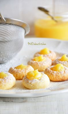 Lemon Curd Cookies are the most yummiest bite size, crisp, melt in the mouth cookies with a spoonful of smooth, silky, tangy, sweet Lemon Curd filled into it.
