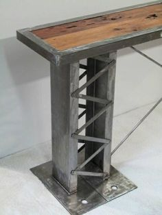 Custom made reception table that is modern yet also industrial. The design is inspired from German and local bridge architecture combined with all the elements, glass, structural steel and reclaimed hardwood. This can be made to suit any home or office and any size. Unique to